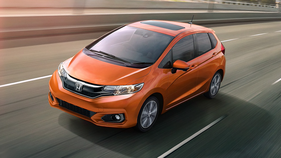 2019 Honda Fit LX shown in Orange Fury