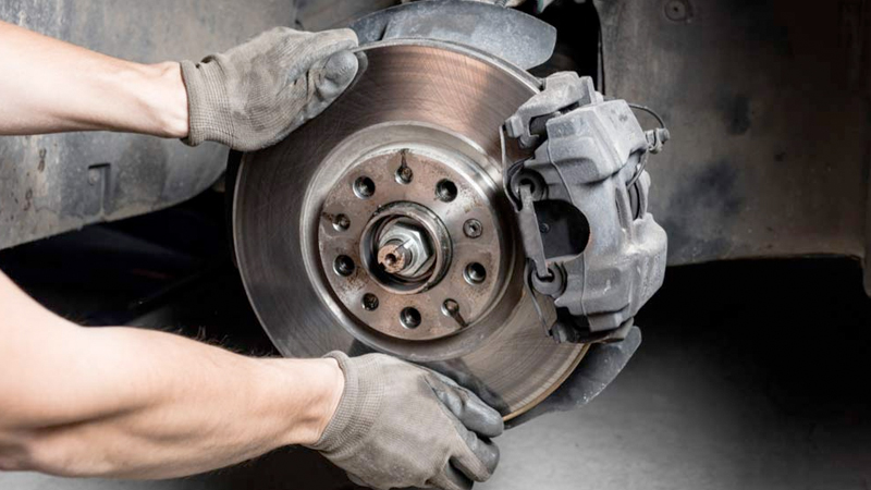Auto Technician Replacing Brake Rotors