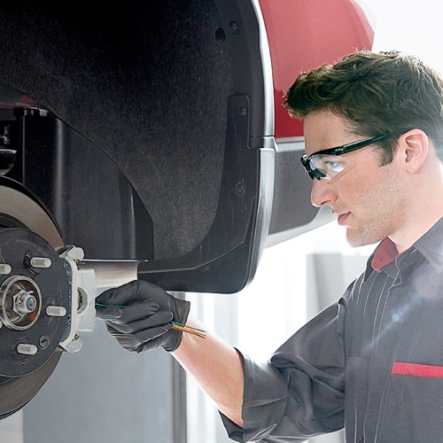 Nissan Service Technician performing brake service