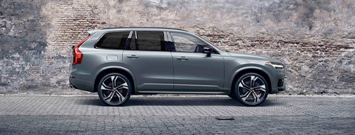 2020 Volvo XC90 parked infront of a wall