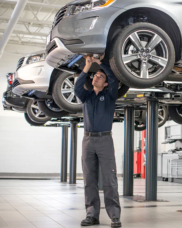 Volvo Mechanic Inspecting Vehicle