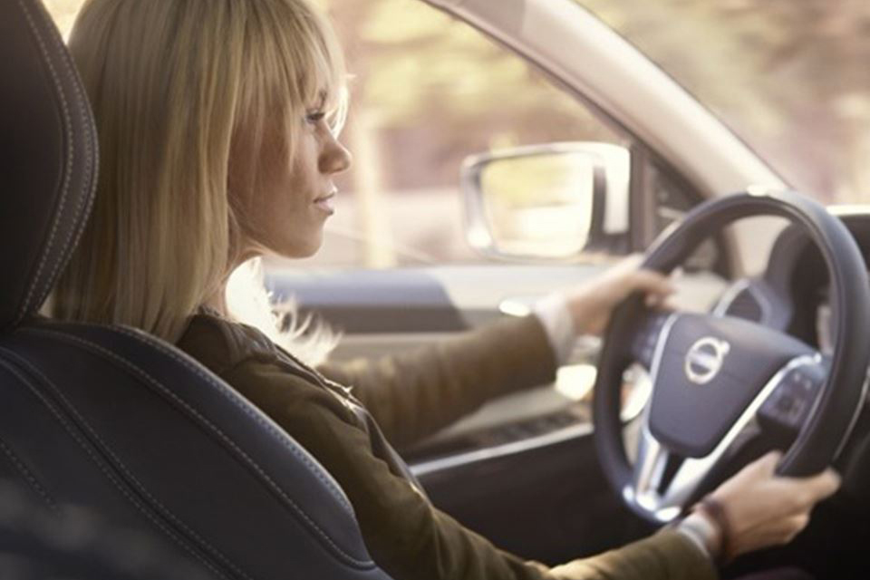 Lady Driving New Volvo